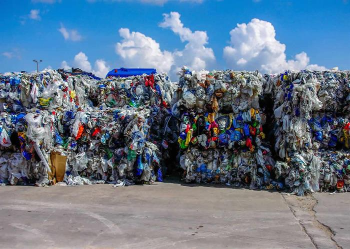 naem-2018-article-bales-rigid-film-plastics-collected-stacked-700x500