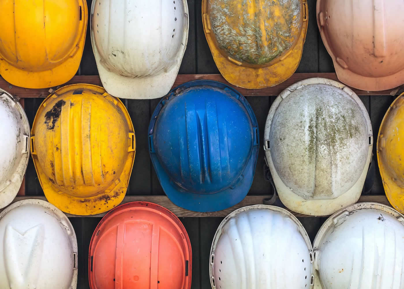 naem-2018-article-old-worn-colorful-construction-helmets-700x500
