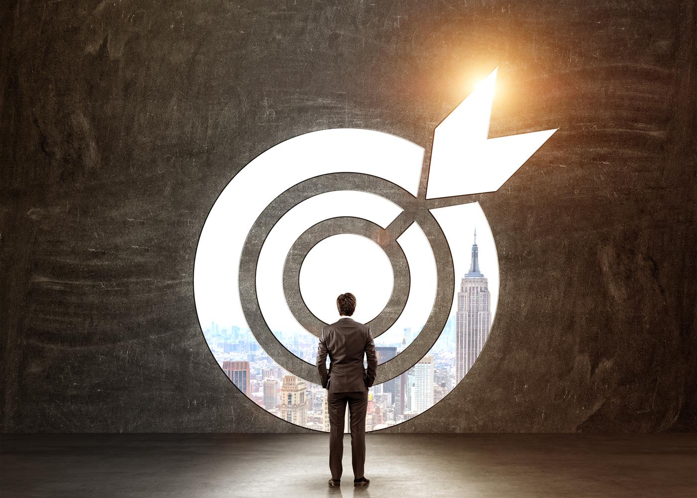 naem-2018-blog-businessman-hands-pockeys-standing-front-target-700x500