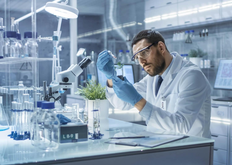 naem-2018-qanda-modern-laboratory-research-scientist-conducts-experiments-700x500