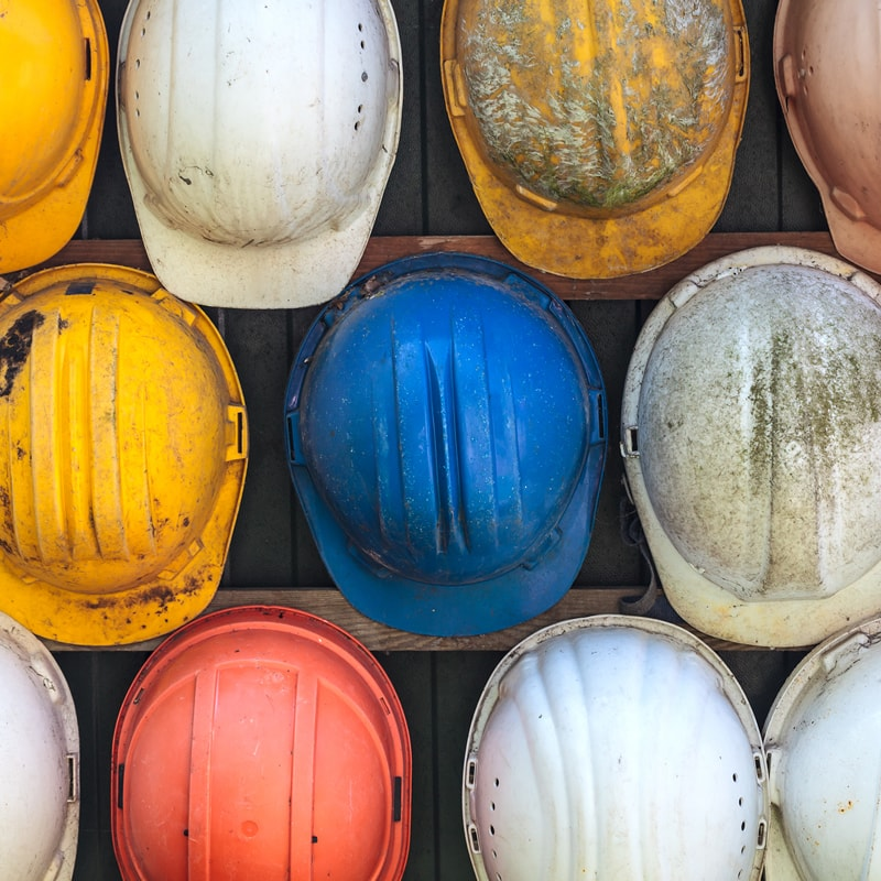 Arial view of multiple hard hats side by side
